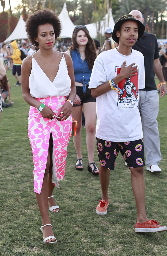 Leave it to Solange Knowles to take her Coachella look to chic heights by tucking a white plunging top into a neon-pink printed midi-length skirt. She completed her look via on-trend white Stuart Weitzman sandals.
