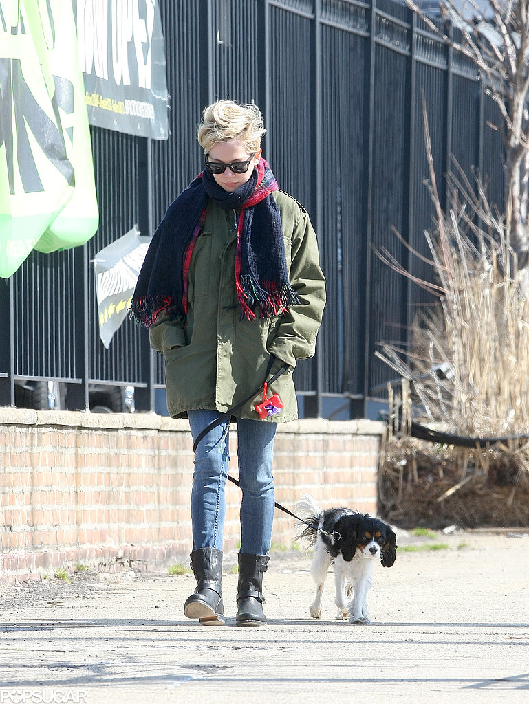 Michelle Williams bundled up in a big scarf.