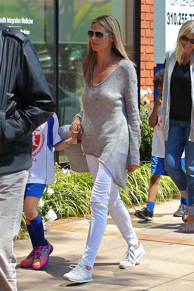 Heidi Klum kept her bottom-half fresh via a pair of white ripped jeans by J Brand and white New Balance sneakers while grabbing lunch in Brentwood.