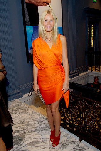 Gwyneth fused not one, but two bold colors at a dinner for Coach in London. The blond beauty paired an orange draped Lanvin confection with fiery Jimmy Choo peep-toe booties.