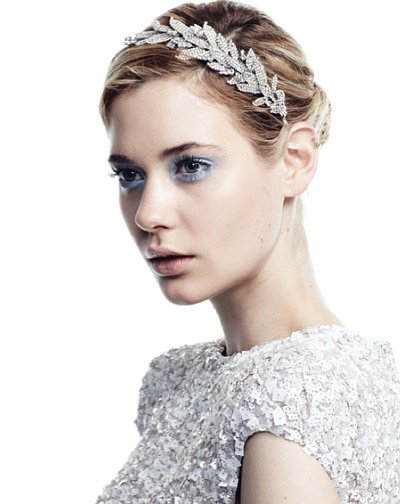 Highlighting a delicate crystal leaf detail, Jennifer Behr's Arielle crystal headband ($1,250) is a true masterpiece, fit for every princess bride.