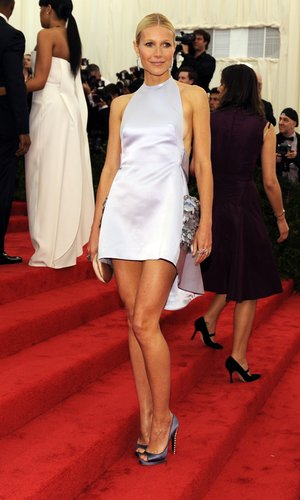 At the 2012 Met Gala, Gwyneth showcased her gorgeous gams pairing an embroidered Prada halter with embellished steel-hued peep-toes.