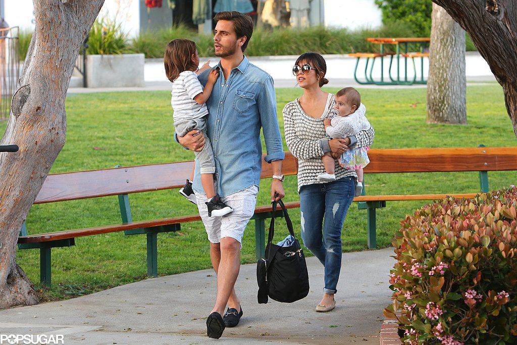 Kourtney Kardashian and Scott Disick carried their little ones, Mason and Penelope, to a park in Malibu, CA.