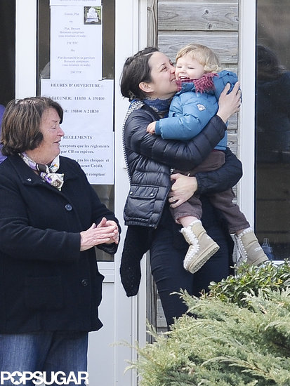 Marion Cotillard planted a kiss on her son, Marcel, at husband Guillaume Canet's International Jump Bost in France.