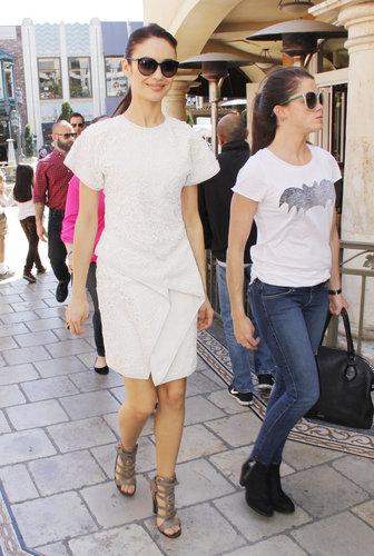 Olga Kurylenko's little white (sculptural) Salvatore Ferragamo dress and gray cutout sandals were fresh among a sea of denim and flats at The Grove in LA.