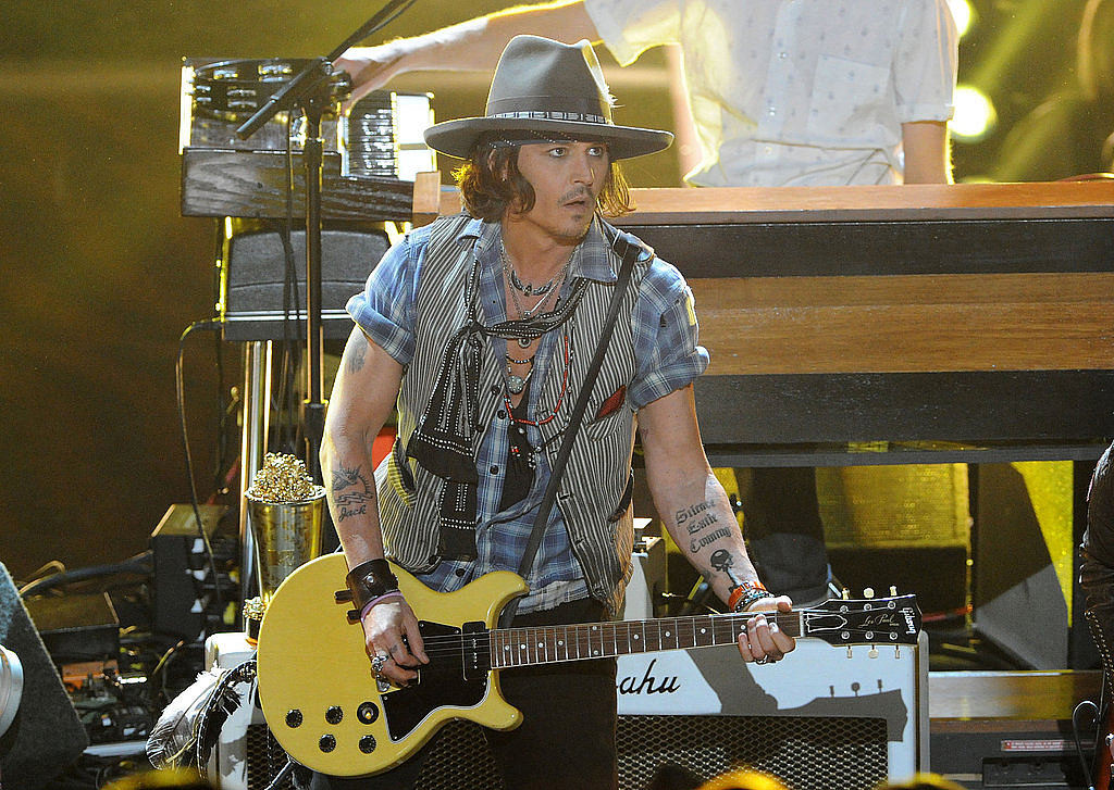 Johnny Depp took the stage to show off his guitar skills at the 2012 show.