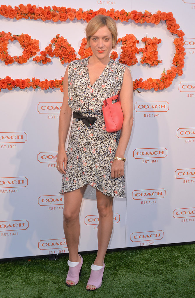 Chloë Sevigny was feminine in a printed Balenciaga dress and a coral-hued Coach Legacy basket clutch.