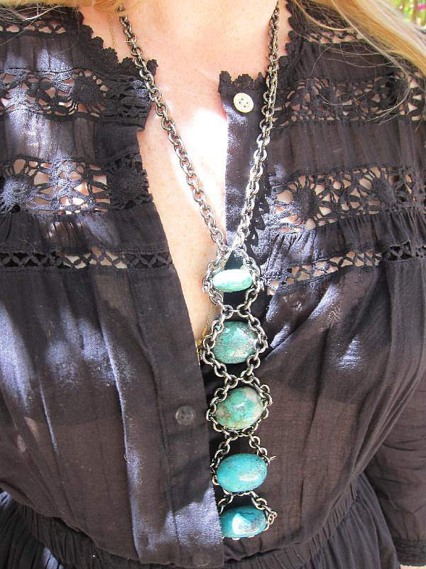 We adore the length of this brushed metal and turquoise stone necklace that's totally a wearable piece of art.