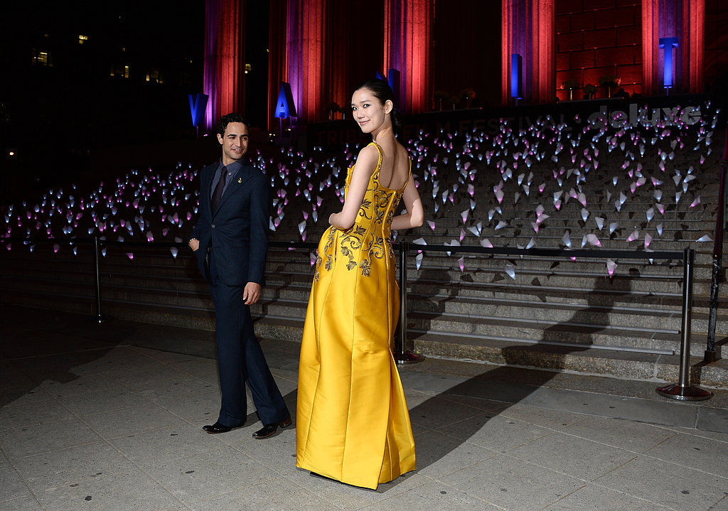 Zac Posen and his model date Tao Okamoto posed outside the New York State Supreme Courthouse, and to top it all off, Okamoto looked glamorous in one of the designer's Fall '13 gowns.