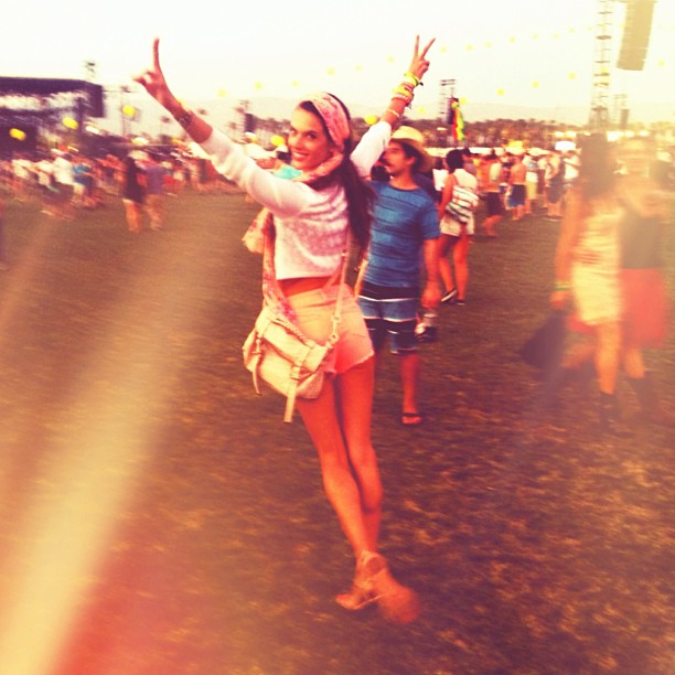 Alessandra Ambrosio flashed double peace signs while hanging out at Coachella. Source: Instagram user alecambrosio