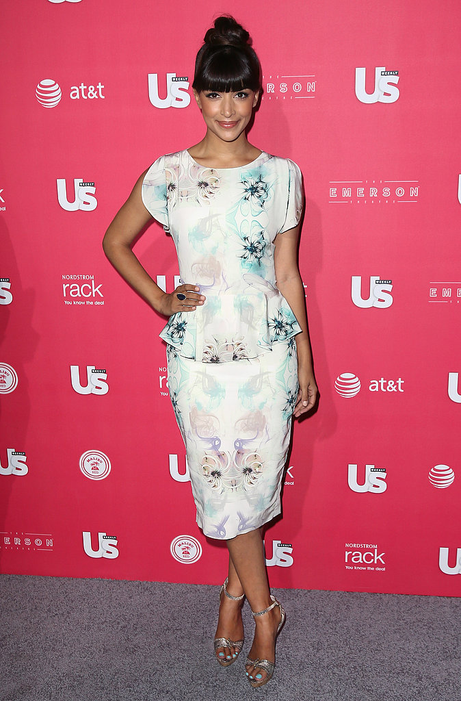 Hannah Simone was darling in a floral Tabitha Webb peplum shift dress and metallic ankle-strap sandals at the Us Weekly Hot Hollywood event in LA.
