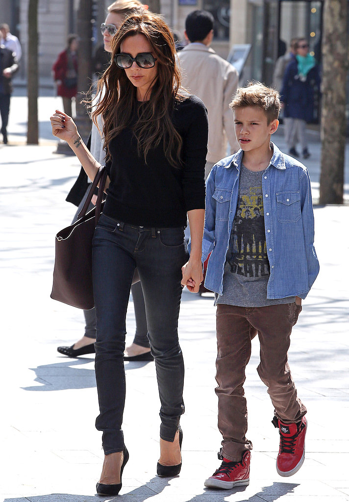 Victoria Beckham held hands with Romeo Beckham.