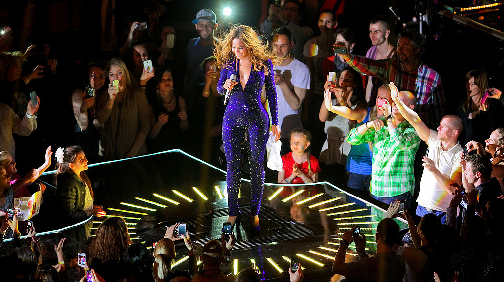 Beyoncé shimmered in a plunging purple sequined jumpsuit.