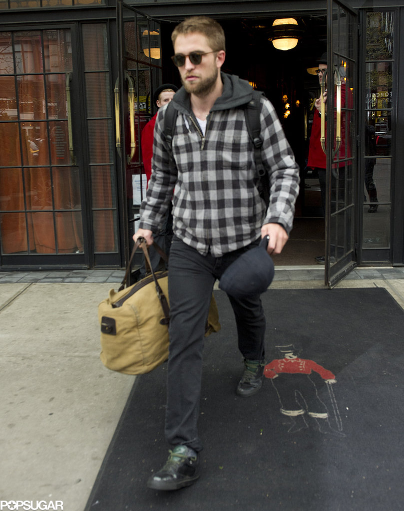 Robert Pattinson carried his bag out of his NYC hotel.