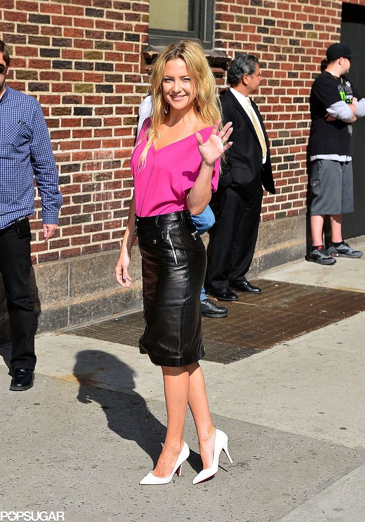 Kate Hudson tucked a bright pink tee into a black leather pencil skirt (both by Michael Kors) accessorized with crisp white Christian Louboutin pumps while visiting The Late Show in NYC.