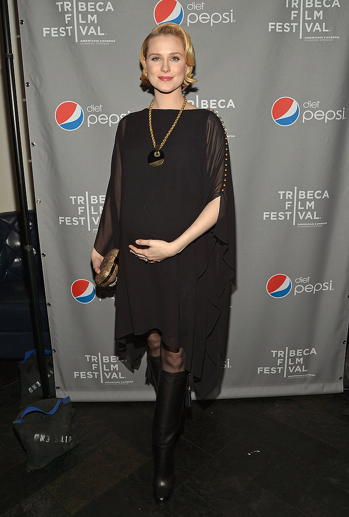 Evan Rachel Wood attended the A Case Of You after party in a black tunic with sheer sleeve details, oversized statement necklace, and knee-high boots.