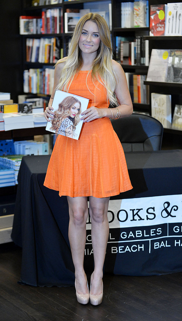On a 2012 promotional book tour, Lauren chose an orange Harlyn fit-and-flare to greet fans and sign copies in Bal Harbour, FL. Lesson from Lauren: embrace Summer with an orange fit-n-flare.
