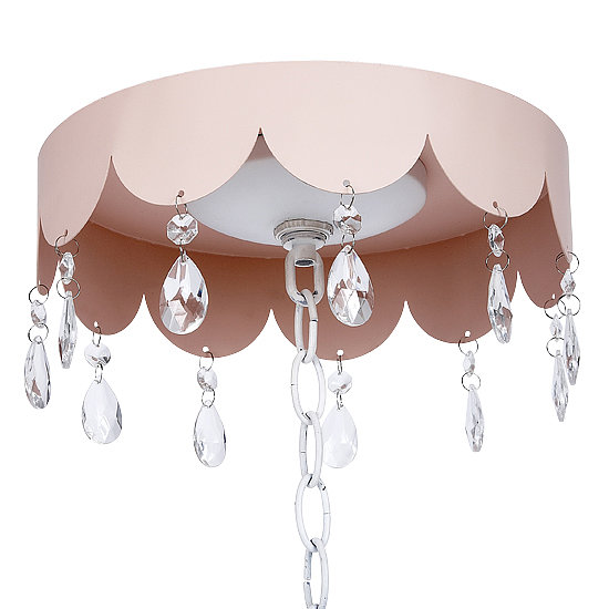 Give your nursery some glitz and glam with this scalloped crystal medallion ($58).