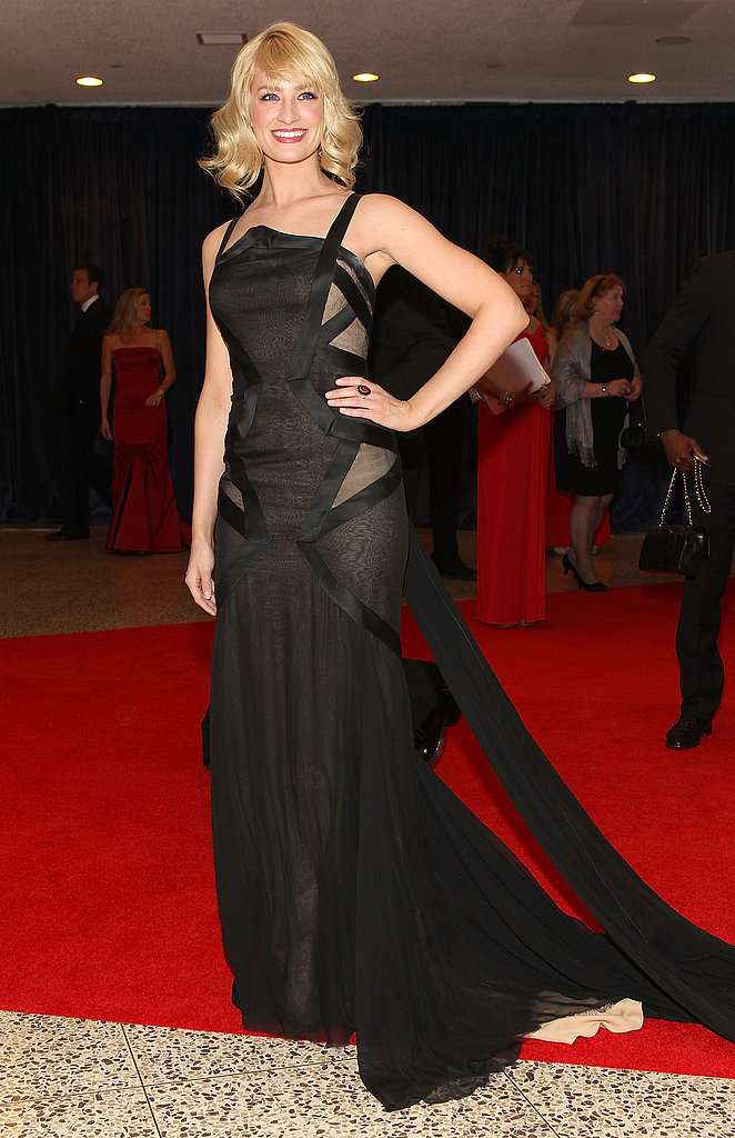 Beth Behrs chose an anything-but-basic black Donna Karan Atelier gown, complete with angular, sheer cutouts. She finished her look with Marina B jewelry.