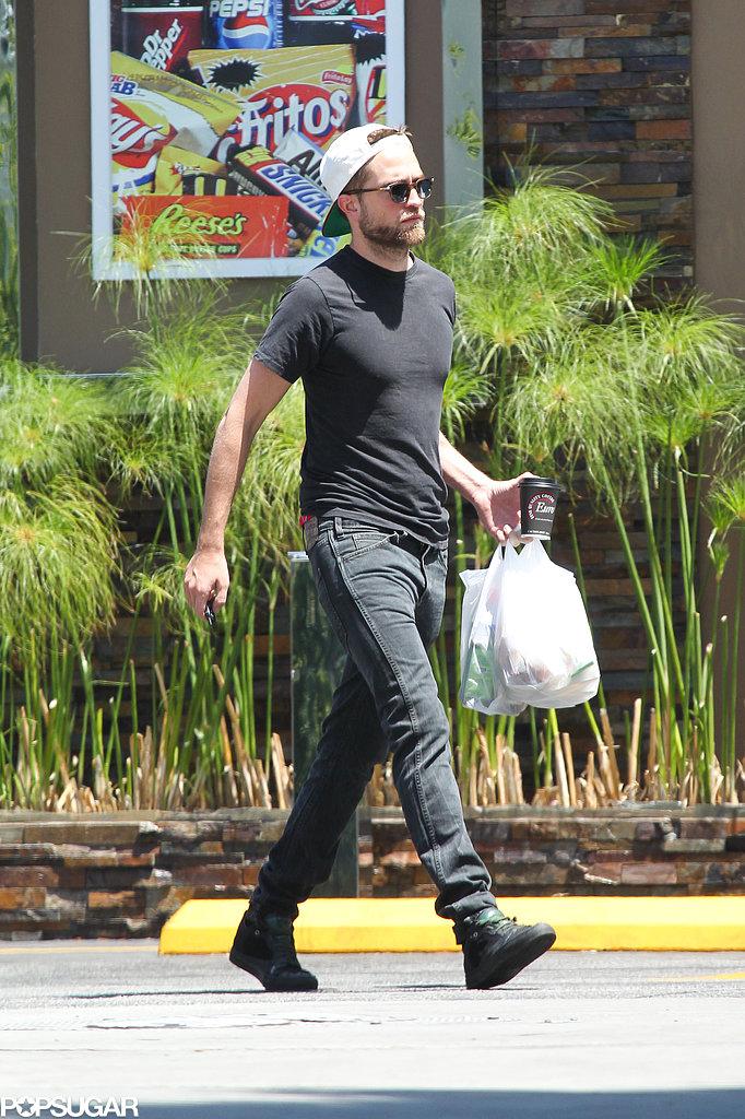 Robert Pattinson wore a backwards cap.