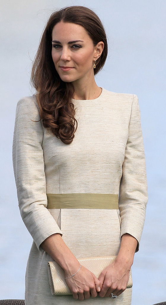 She looked polished and beautiful with a centre-parted blow dry on day six of their Canadian tour in 2011.