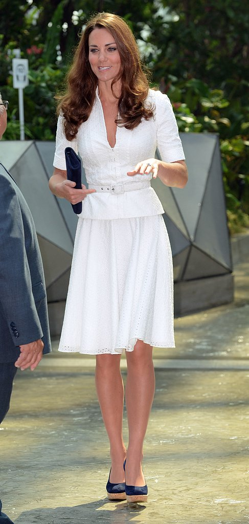 In a more casual white pick, she ditched the ornate fascinator and dressed it down in her preferred shoe of choice: wedges.