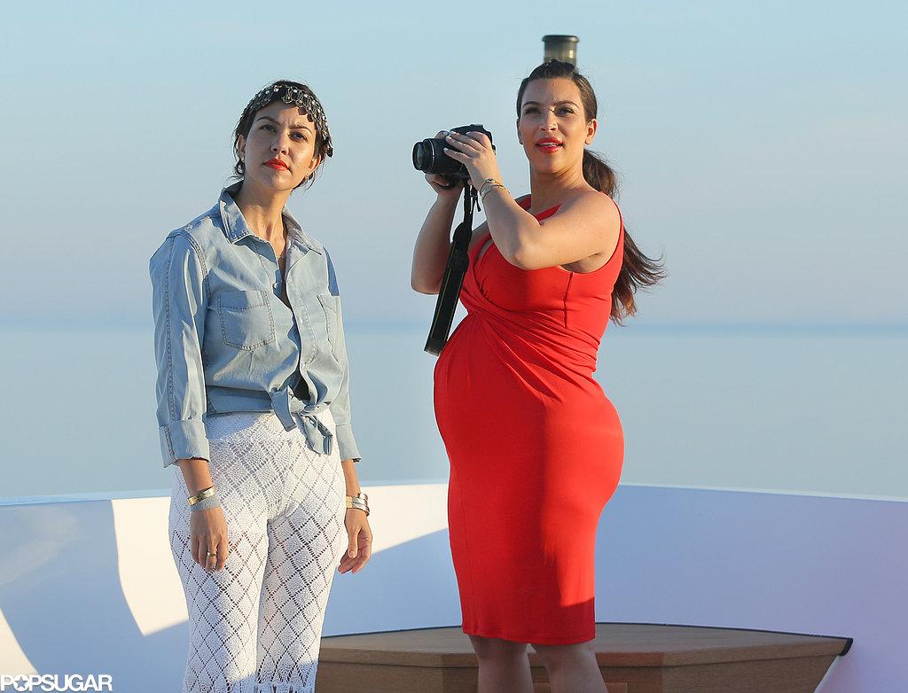 Kim and Kourtney Kardashian took pictures in Greece.