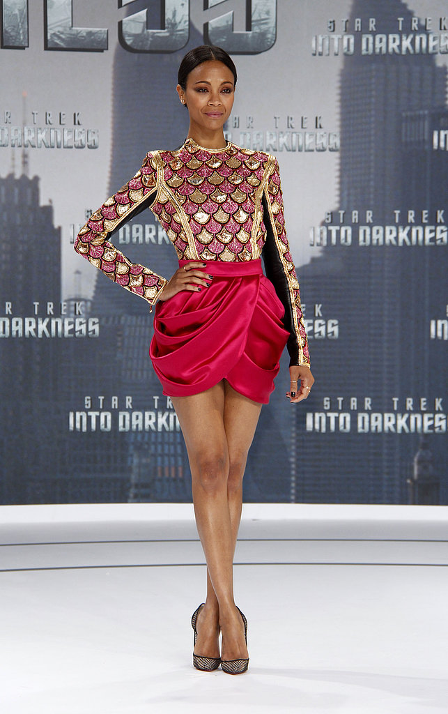 At the Berlin premiere of Star Trek Into Darkness, Zoe Saldana skipped the midriff-baring antics and went with a very sexy leg-baring number, courtesy of Balmain. The pink-and-gold shell-like embellishment on the long-sleeved top and tulip-silhouette skirt provided two different kinds of dynamic in one outfit. To finish it all off, she wore Christian Louboutin pumps and EF Collection jewelry.