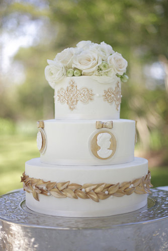 The great thing about this gold-detailed cake is that it reflects another time period but is still totally appropriate for a modern-day wedding.  Photo by Shane Snider Photography via Style Me Pretty