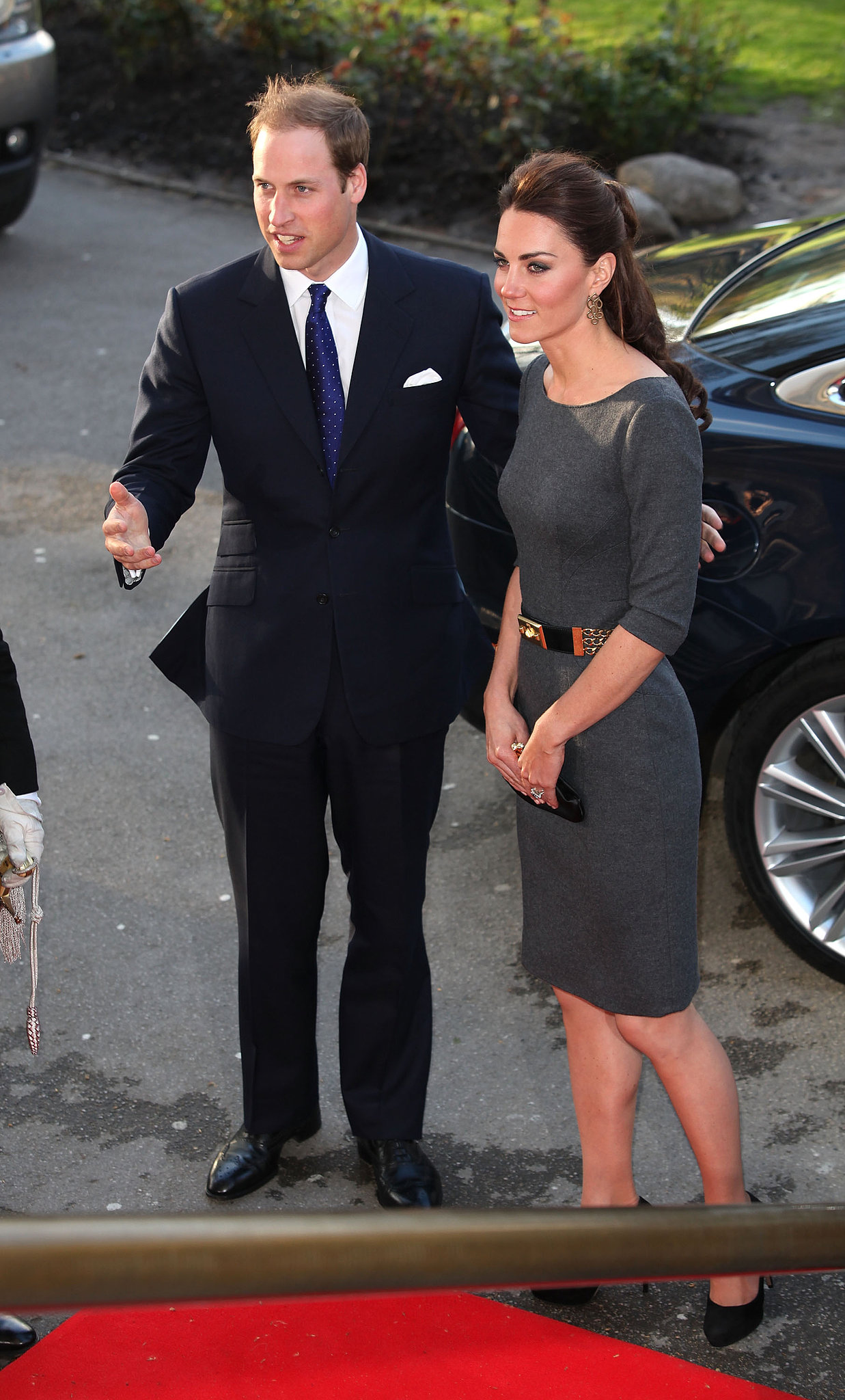 Prince William and Kate kept close on their way into a 2012 royal appearance at the Imperial War Museum in London.
