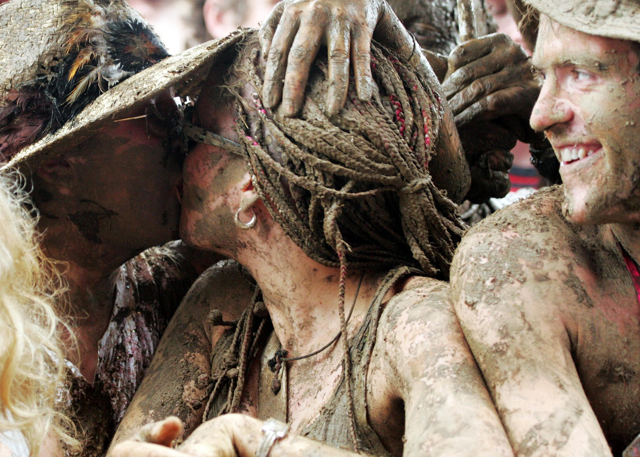 A very muddy twosome kissed at the Glastonbury Music Festival in England.