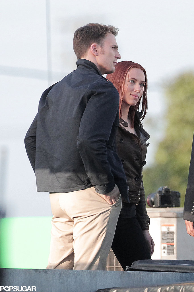 Scarlett Johansson and Chris Evans chatted with another actor.
