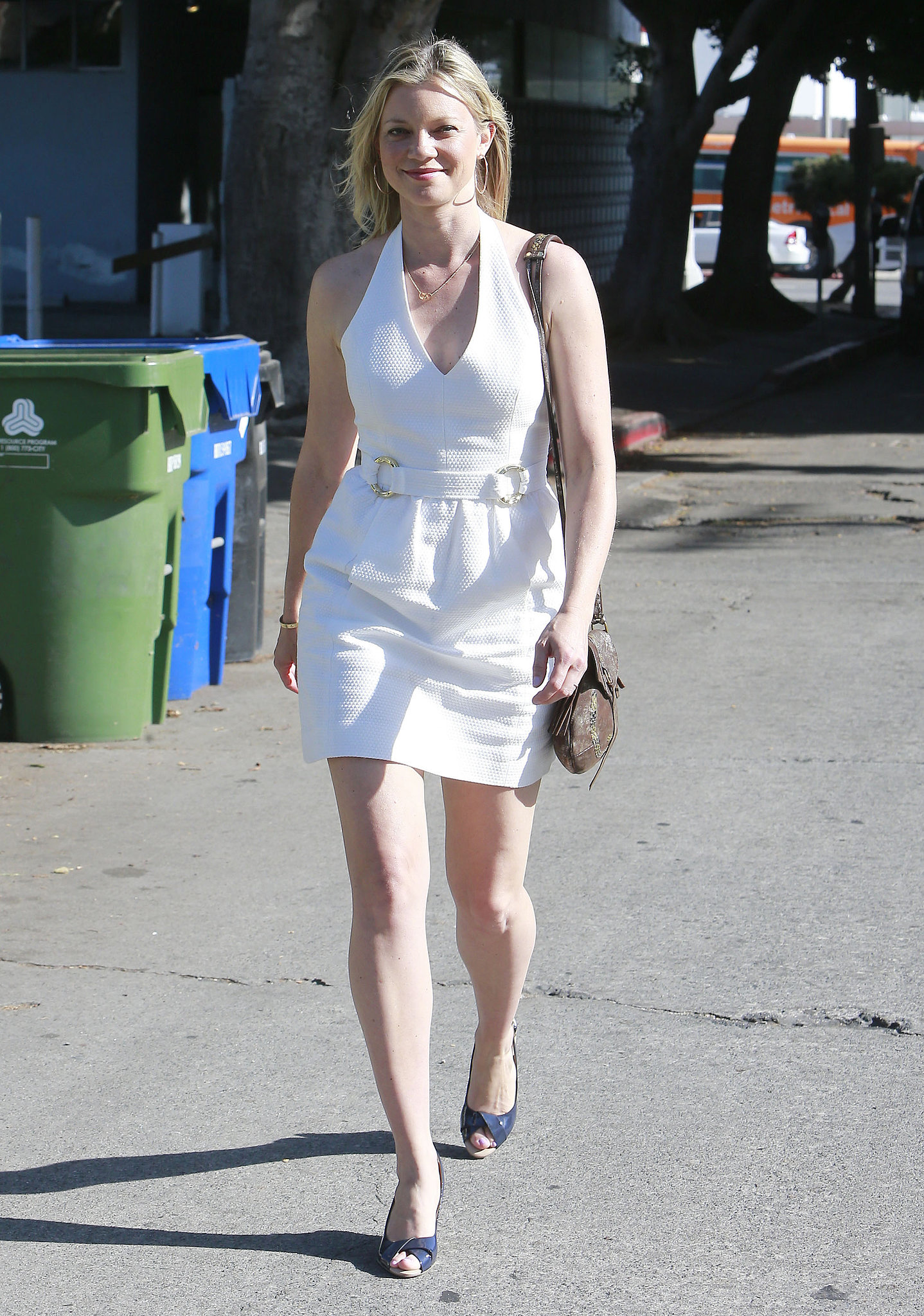 In la in a plunging white halter dress navy peep toes and a brown