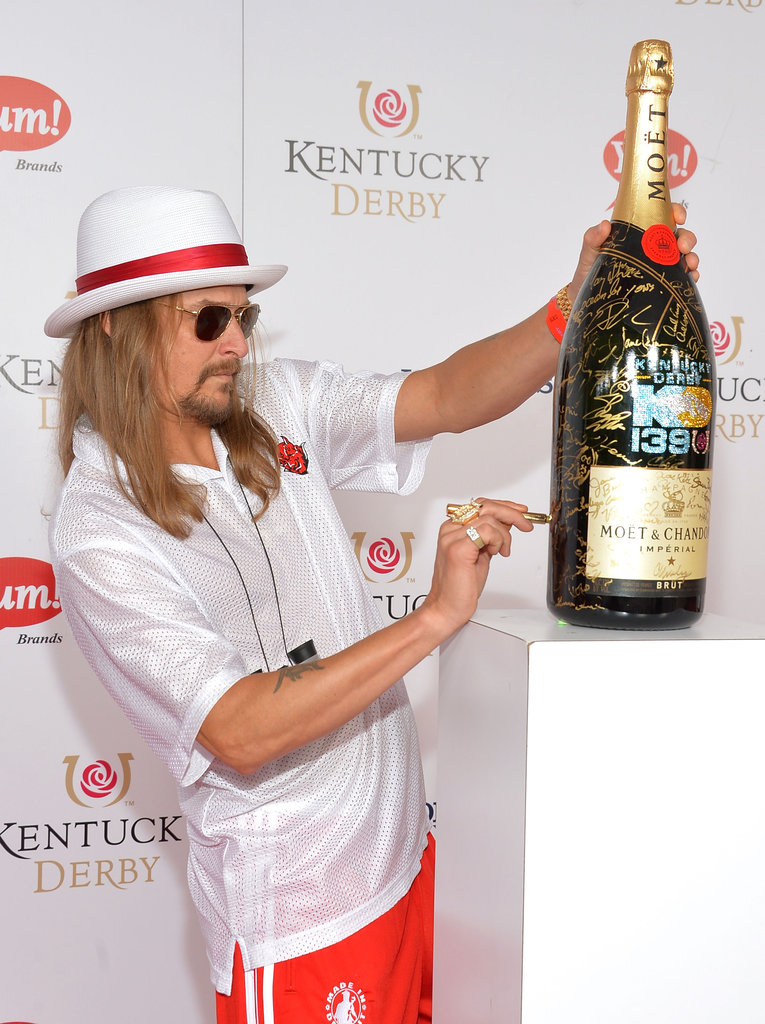 Kid Rock signed a bottle of Moët & Chandon on his way into the races on Saturday.