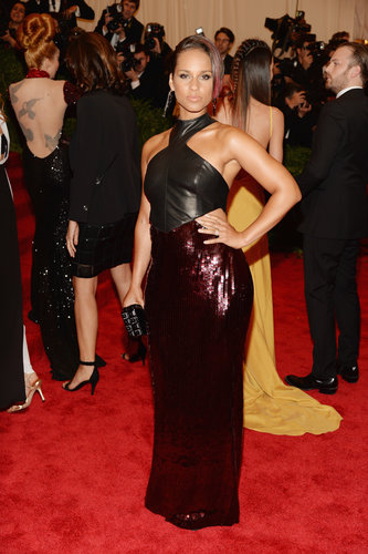 Alicia Keys wore a custom black leather and bordeaux sequin-embroidered halter gown by Jason Wu, Robert Lee Morris jewelry, Casadei heels, and paired it with a vintage clutch.