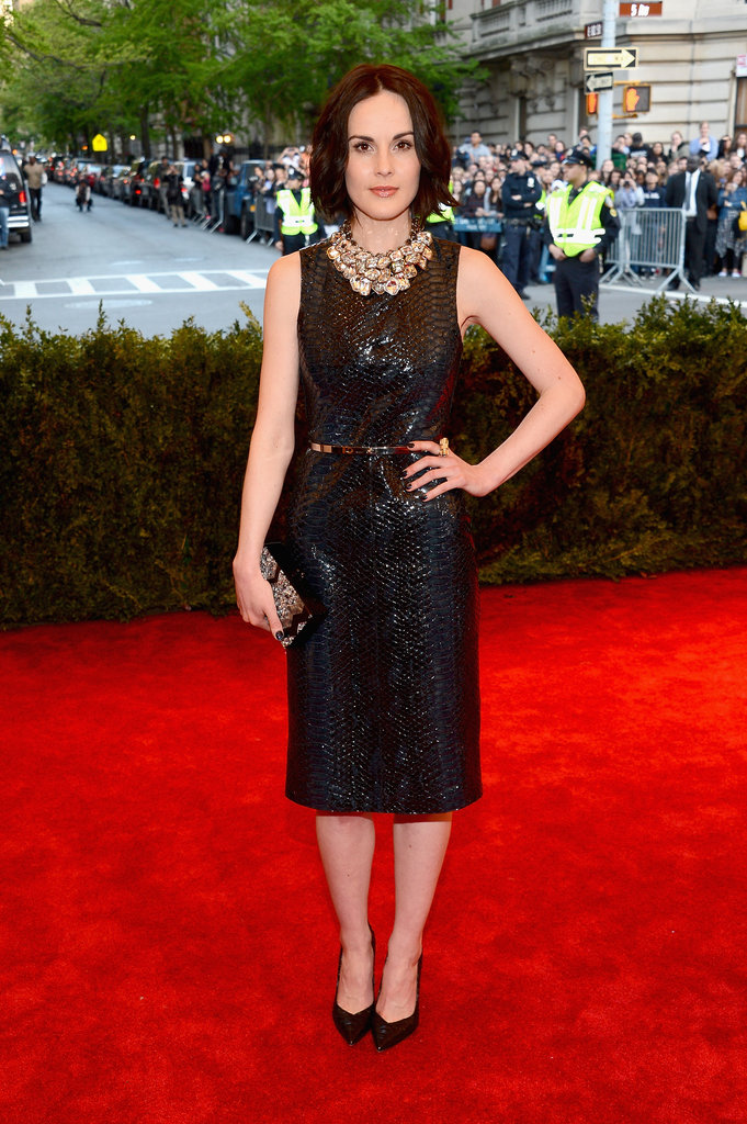 Michelle Dockery's Burberry python-print leather shift dress was ladylike in silhouette but totally punk in fabric. She finished the look with Gianvito Rossi pumps.