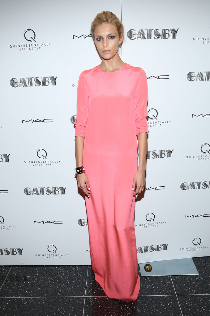 Anja Rubik hit the carpet in a gorgeous high-impact pink gown.