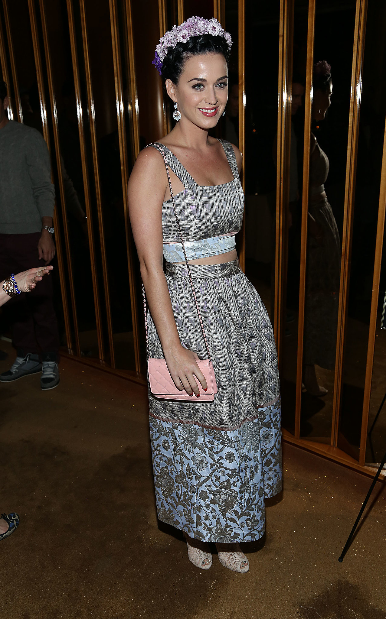 Katy Perry showed off her signature, girlie-meets-whimsical styling in a crop top and full skirt, complete with a floral headpiece and Lia Sophia jewels.