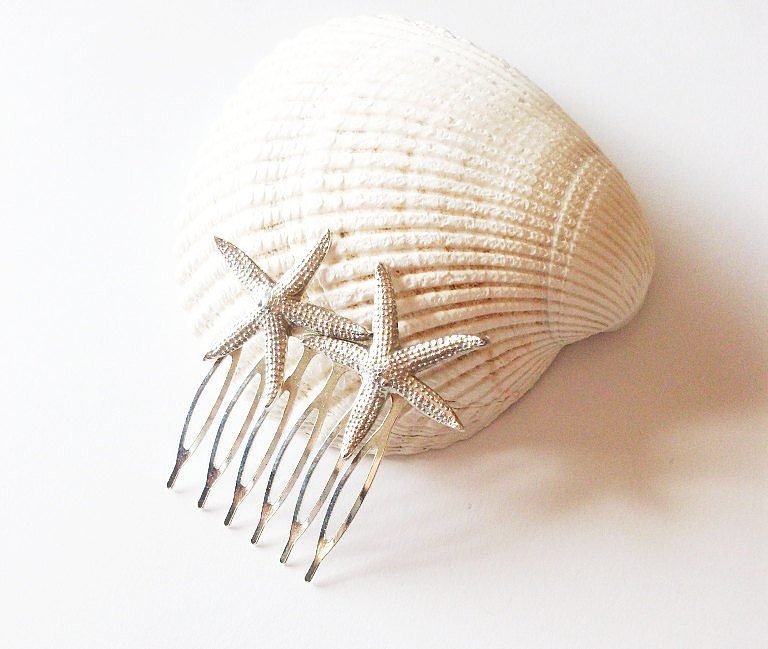 A starfish hair comb ($36) is the perfect accent for a seaside wedding.