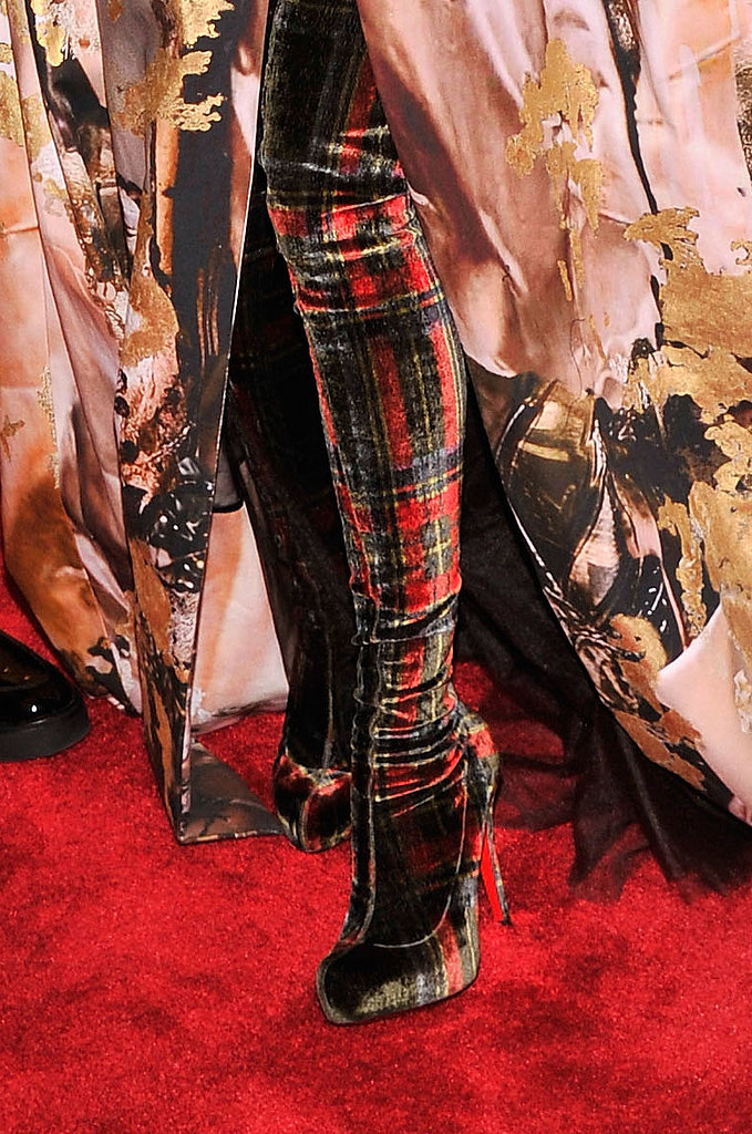 Sarah Jessica Parker wore plaid Christian Louboutin boots.