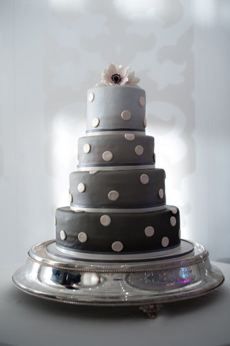 Ombré gray tiers modernize this cake's polka-dot detail.  Photo by Steve DePino via Style Me Pretty