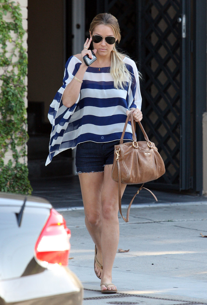 Conrad topped her denim cutoffs with a flowing striped top on her way to the salon in LA. Lesson from Lauren: stripes are always in style.