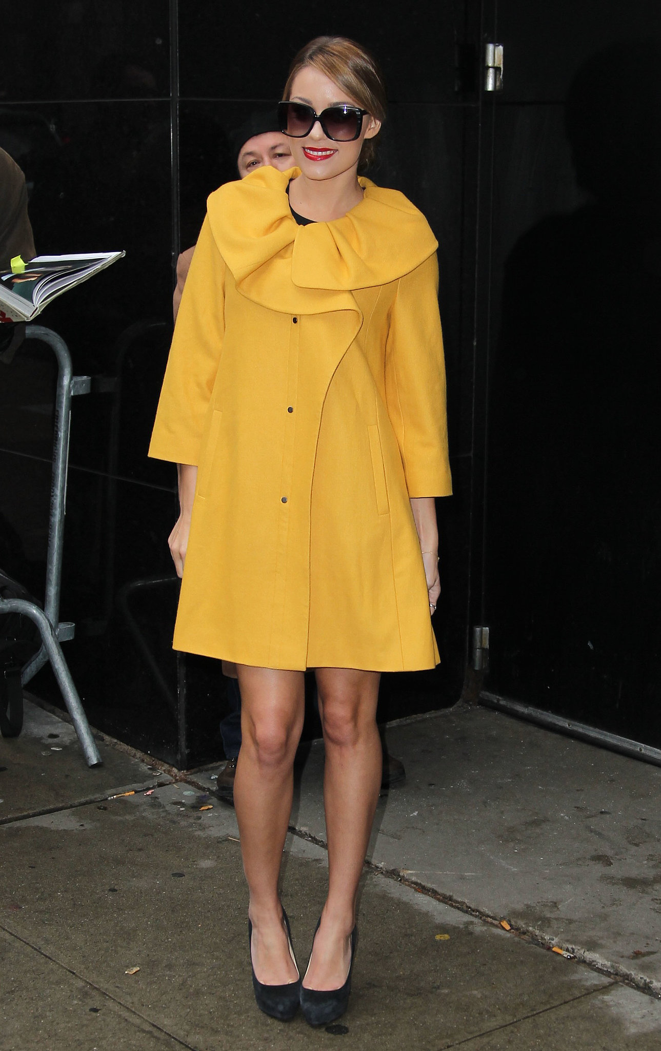 While out and about in NYC, Conrad worked a bright yellow coat, complete with ruffle detail. Lesson from Lauren: never underestimate the power of a statement coat.