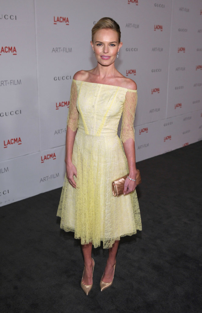 Kate Bosworth's pale yellow lace midi-length dress and gold accessories would fit in at a winery, especially if the bride is clad in a soft lace off-the-shoulder gown, too.