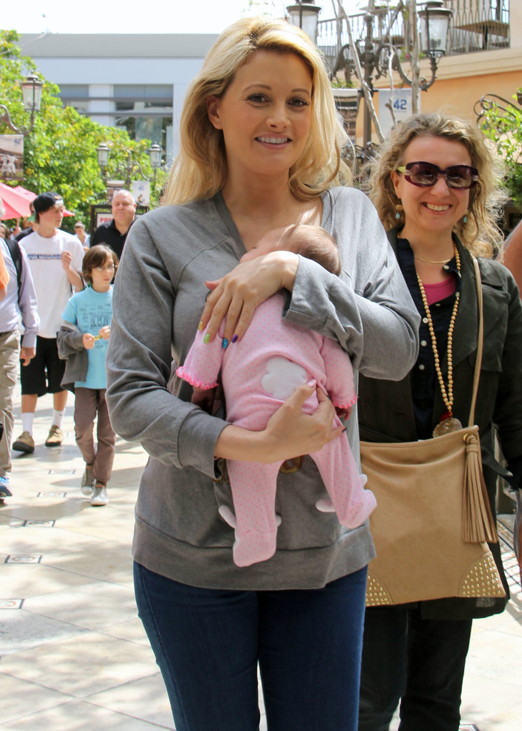 Holly Madison is settling into motherhood with her daughter, Rainbow Aurora Rotella, who was born in March 2013.