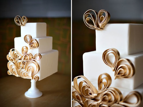 This modern cake has a bit of whimsy with graphic gold detail that pops against the cake's white fondant.  Photo by Jasmine Star via Green Wedding Shoes
