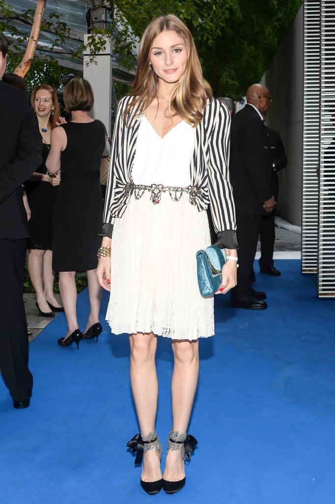 With a striped jacket, jeweled belt, and delicate ankle-strap heels, Olivia set her LWD apart from the rest of the cocktail party crowd at an event at the MoMA in May. Joe Schildhorn /BFAnyc.com