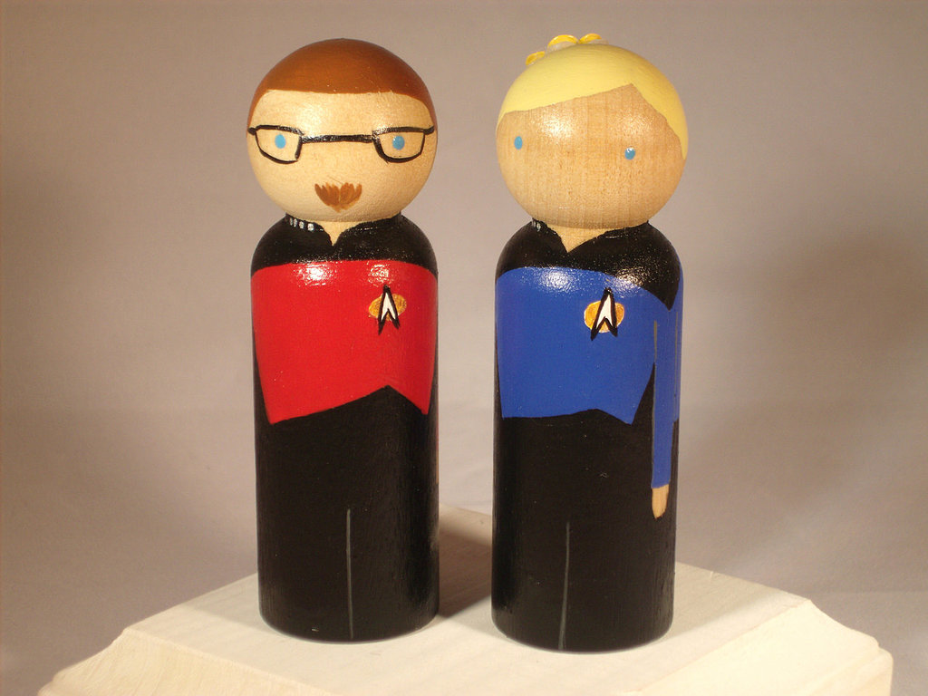 Sweet and simple, wooden doll toppers like this Trekkie pair ($68) will add a fun touch to your big day.
