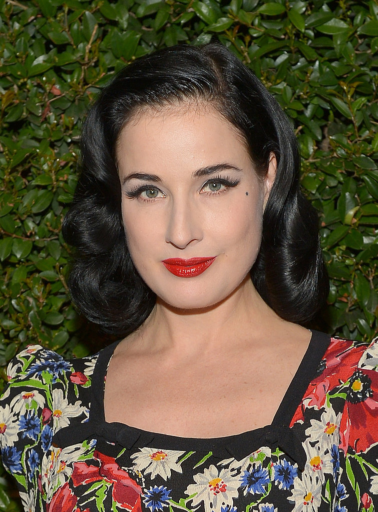 Of course, Dita Von Teese stuck with her usual formula of cherry-red lips, cat eyeliner, and vintage waves for the Mac Cosmetics and Vogue dinner.