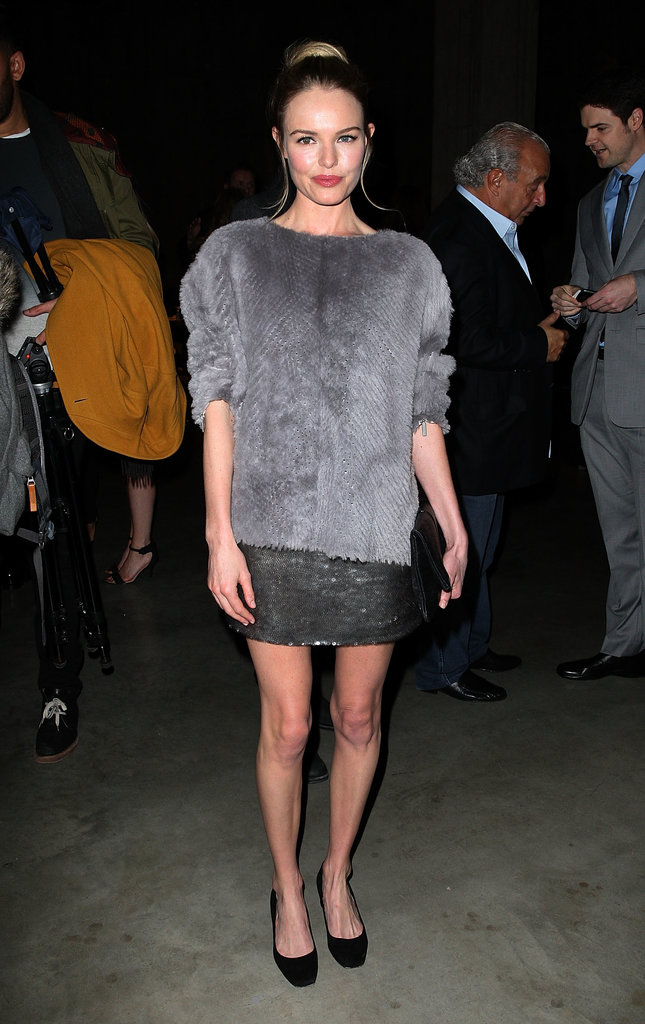 Kate Bosworth looked part cosy, part glitzy in a textured grey topper, sequinned mini-skirt, and black pumps at the Topshop Unique fashion show during Fall/Winter 2013/2014 London Fashion Week.